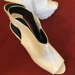 White bootie shoe by Qupid